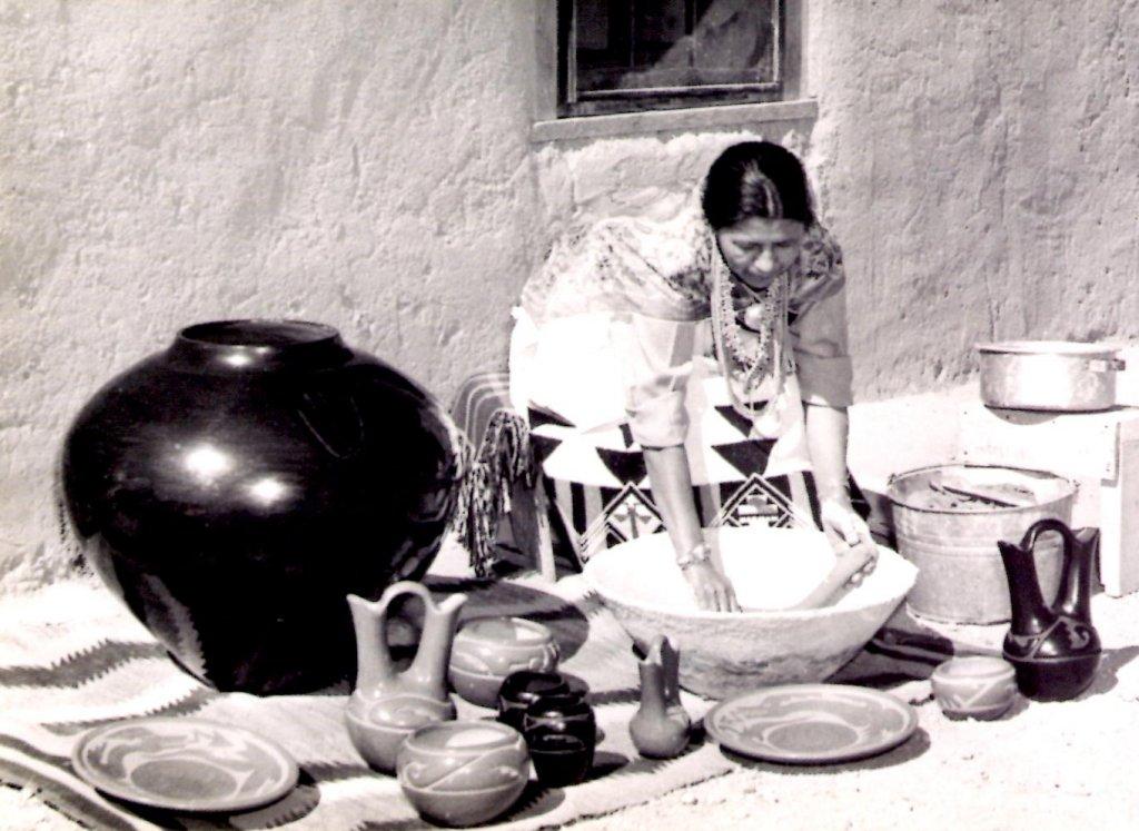 Margaret Tafoya making pottery